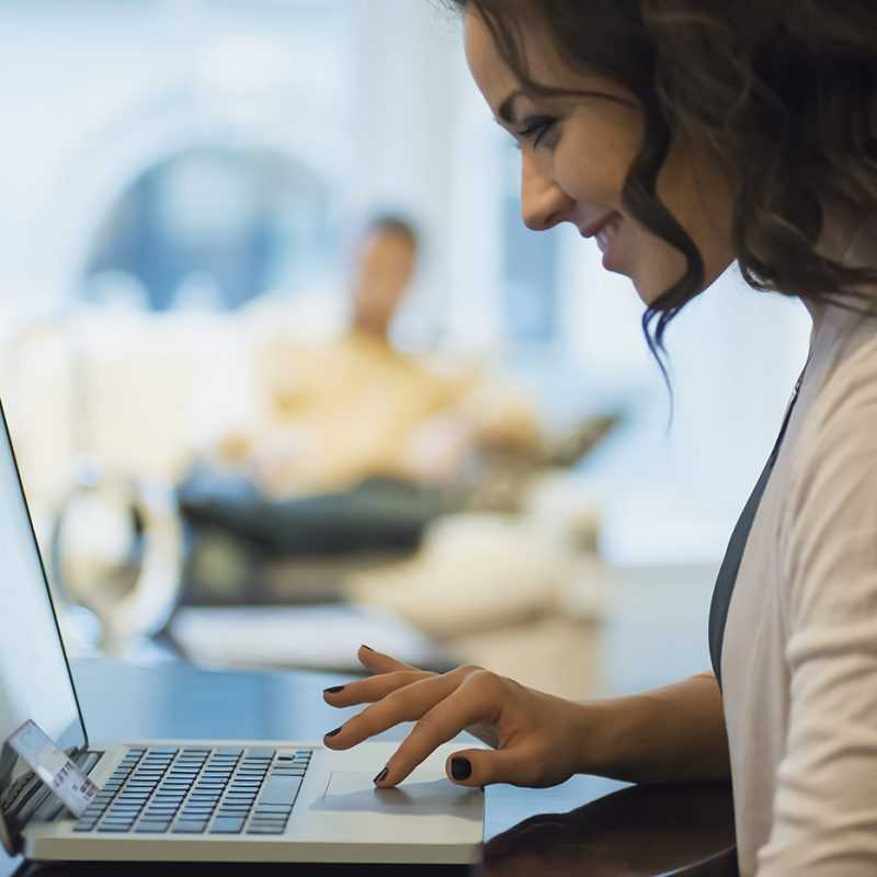 Woman on-line shopping on laptop